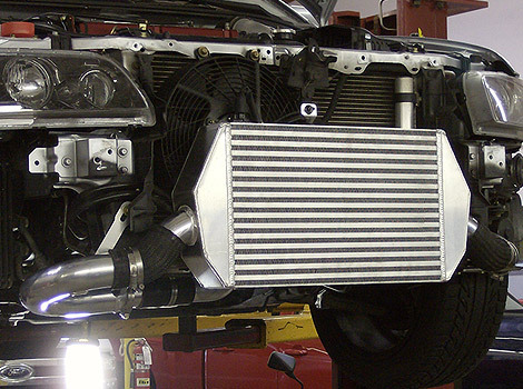 Beefy intercooler and compressor outlet on Mitsubishi Evolution