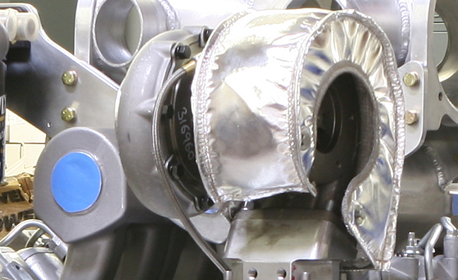 Shields protect the twin turbos and boost air from outside heat.