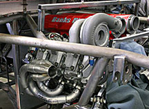 Exhaust manifold shown mounted on D-Max Type-R engine in chassis. Note efficient path to turbocharger.