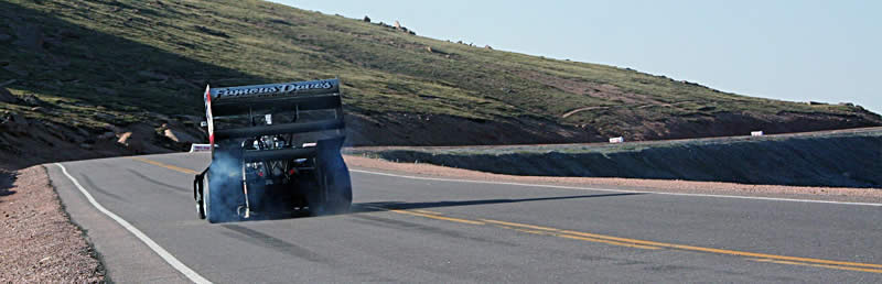 An avid artist, Paul Dallenbach uses his right foot and a 1,400-horsepower Banks Power twin-turbo Chevy V8 to paint thick black Continental rubber stripes on the asphalt while practicing on the upper section of the course.