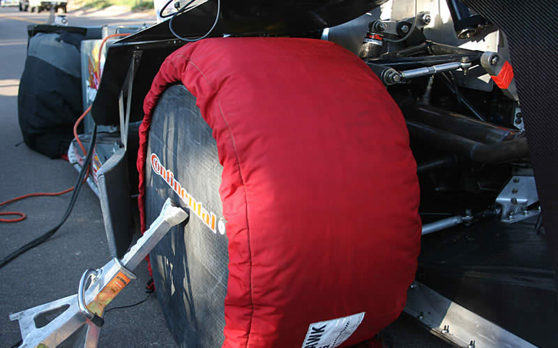Cold temperatures and race tires do not go well together so the team employs tire warmers and side covers (along with a jack stand to keep the covers on in the gusty wind) to keep the tires at a balmy 180-degree surface temperature before runs.