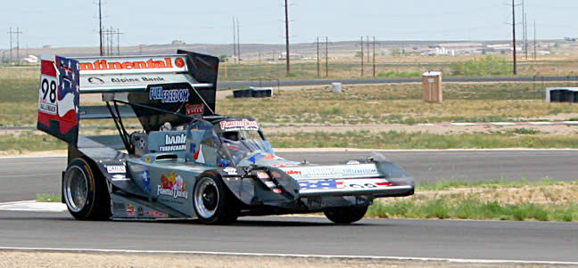 Looking closely at the car as Dallenbach rockets out of the corner on the Pueblo road course you can see that the rear end is solidly planted while the inside front tire is nearly lifted off the ground.