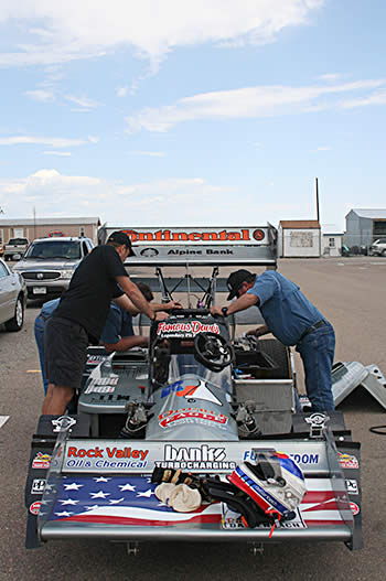 After a few laps on the track the small group of hot-rodders make some minor tweaks to the car adjusting the brake bias, shock tuning and pressure in the rear tires.