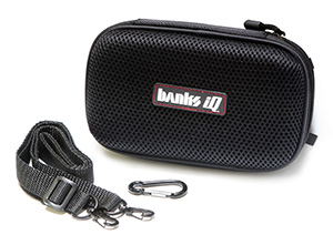 System includes travel case with integrated speakers, detachable carrying strap, and carabiner clip.